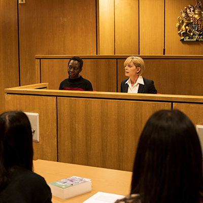 Students take part in a realistic hearing in our mock courtroom