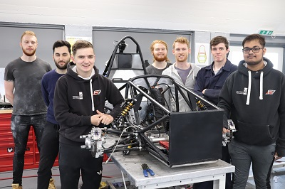 Members of the Formula Student team working on the car