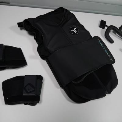 The Tactot Haptic Vest, Tactal haptic face cushion, and Tactosy pair of haptic sleeves