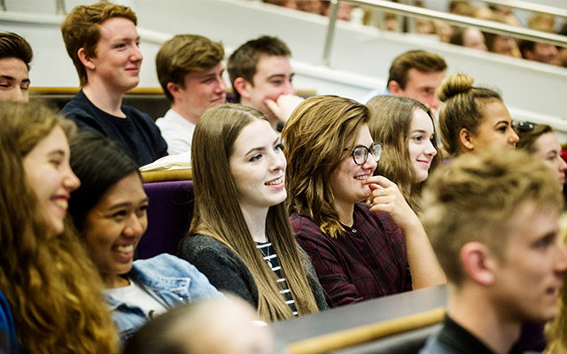 students listening to a welcome talk